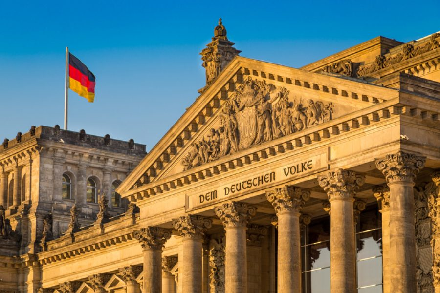 Close-up view of famous Reichstag building, seat of the German Parliament (Deutscher Bundestag), in beautiful golden evening light at sunset, Berlin, Germany.
